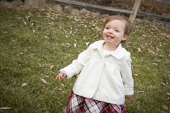 Cute Baby Girl Running in Park Stock Images