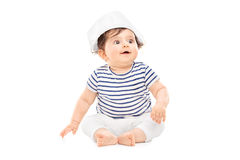Cute baby girl in sailor outfit sitting on the floor Royalty Free Stock Photography