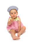Cute Baby Girl Sitting. And finishing her meal, isolated over white background royalty free stock image