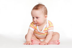Cute baby girl sitting. Royalty Free Stock Photography