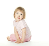 Cute baby girl sitting on the floor Stock Image