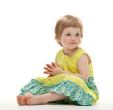 Cute baby girl sitting on the floor Stock Photo