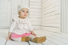 Cute baby girl sitting on the floor Stock Photography