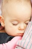 Cute baby girl sleeping Stock Photos