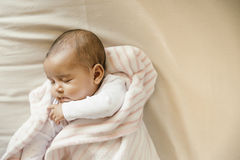 Cute Baby Girl sleeping in the Crib Royalty Free Stock Images