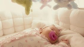Cute baby girl sleeping in her cot Royalty Free Stock Photography
