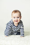 Cute Baby Girl. Small Child Wearing Striped T-Shirt Royalty Free Stock Images