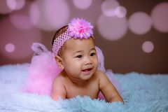 Cute baby girl from Asia pose stock photos