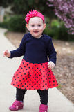 Cute baby girl standing Stock Image