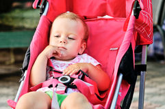 Cute baby girl in stroller Royalty Free Stock Photo