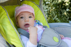 Cute baby girl in stroller Stock Photography