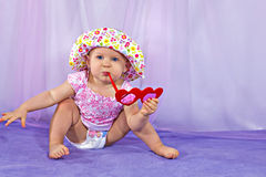 Funny baby girl in a summer hat Royalty Free Stock Photo