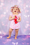 Little adorable baby girl with heart sunglasses Stock Photos