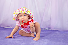 Pretty baby girl in a summer hat Stock Photos
