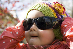 Cute baby girl with sunglasses Stock Photos