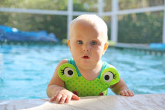 Cute Baby Girl in Swimming Pool on Summer Day Stock Images