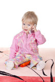 Cute baby girl talking on mobile phone. Isolated on white Royalty Free Stock Photo