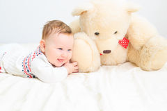 Cute baby girl and teddy bear Royalty Free Stock Photos