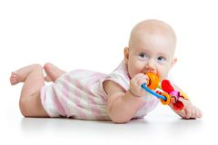 Cute baby girl with teether toy. Isolated on white stock image