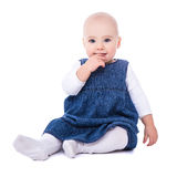 Cute baby girl toddler sitting isolated on white Royalty Free Stock Photo