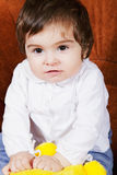 Cute baby girl with toy Stock Photos