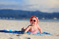 Cute baby girl on tropical beach Stock Photo