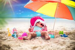 Cute Baby Girl On A Tropical Beach Vacation stock photo