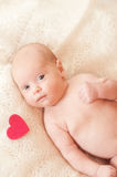 Cute baby girl with valentine heart Royalty Free Stock Images