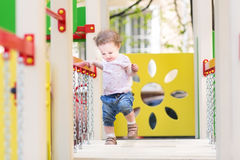 Cute baby girl walking on a playground Royalty Free Stock Photos