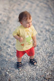 Cute Baby Girl walking. On the playground - very shallow depth of field Stock Images