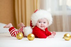 Cute Baby girl weared Christmas clothes. At home Stock Photo