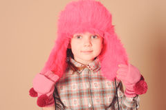 Cute baby girl wearing fur hat Stock Photos