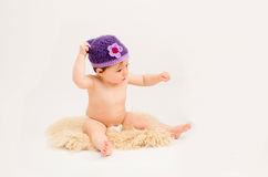 Cute baby girl wearing a hat. Portrait of beautiful baby girl wearing a knitted crochet hat Royalty Free Stock Images
