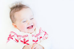 Cute baby girl wearing a knitted snowflake sweater Royalty Free Stock Photography