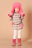 Cute baby girl wearing winter clothes Stock Photos