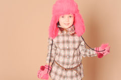 Cute baby girl wearing winter clothes Royalty Free Stock Photo