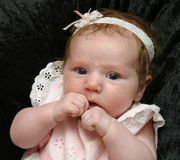 Cute Baby Girl In White. Photo of a baby girl dressed in white royalty free stock photos