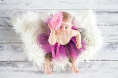 Cute baby girl on a wooden floor Royalty Free Stock Image