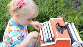 Cute Baby Girl Writing on a Vintage Typewriter Machine. Cute Baby  Girl Writing on a Vintage Typewriter Machine stock video footage