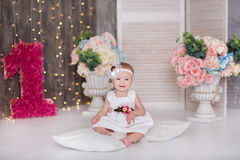 Cute baby girl 1-2 year old sitting on floor with pink balloons in room over white. Isolated. Birthday party. Celebration. Happy b. Irthday baby, Little girl Stock Image