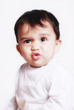 Cute baby giving funny expression Stock Photography