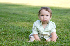 Cute Baby in the Grass Stock Image