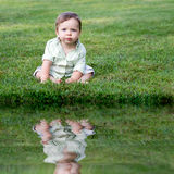 Cute Baby in the Grass Royalty Free Stock Photos