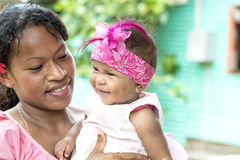 Fijian Baby with hair accessories. Proud mother with cute baby with pink hair accessories in Fiji royalty free stock photos
