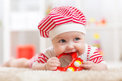 Cute baby in hat on the bed having fun Royalty Free Stock Photos