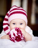 Cute baby in a hat with pompom Stock Photos
