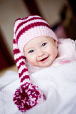 Cute baby in a hat with pompom Royalty Free Stock Photos