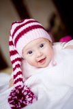Cute baby in a hat with pompom Royalty Free Stock Image