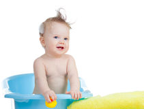 Cute baby having bath in blue tub Royalty Free Stock Photos