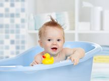 Cute baby having bath in blue tub. Cute baby boy having bath in blue tub stock images